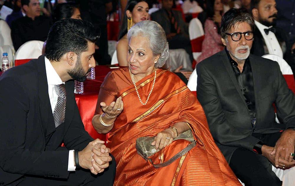 Bollywood actors Amitabh Bachchan with Waheeda Rehman and Abhishek Bachchan during the BIG STAR Entertainment Awards 2014 in Mumbai.