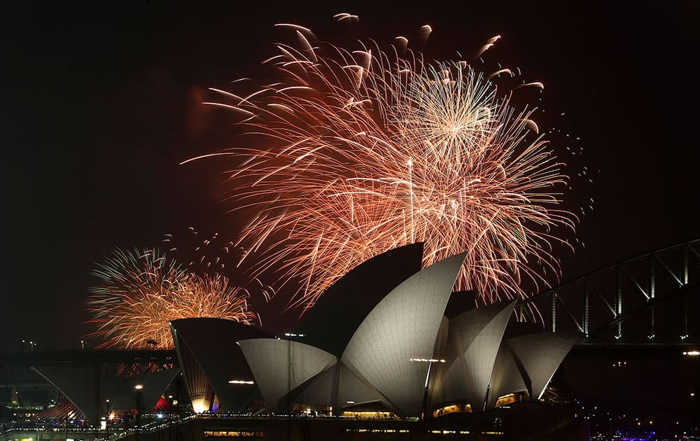 Fireworks explode over the Opera House and the Harbour Bridge during New Year's Eve celebrations in Sydney, Australia.
