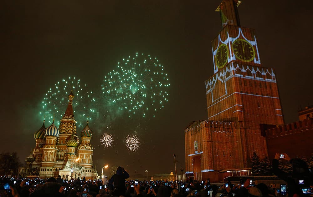The projection of Spassky (Saviour) tower is seen over the scaffold covering the tower, which is user renovation, as fireworks explode over the Red Square during the New Year celebration, in Moscow, Russia.