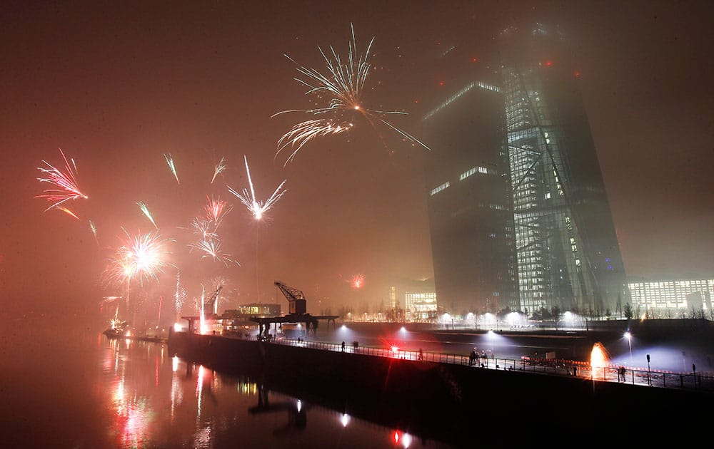 Fireworks explode during New Years celebrations near the new headquarters of the European Central Bank in Frankfurt, Germany.