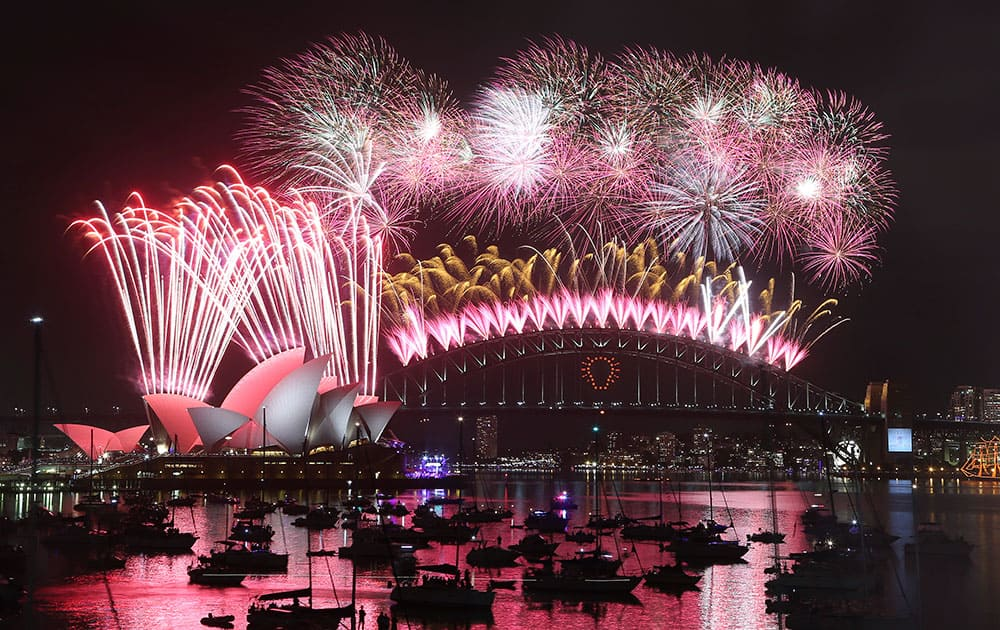 Fireworks explode over the Opera House and the Harbour Bridge during New Years Eve celebrations in Sydney, Australia.