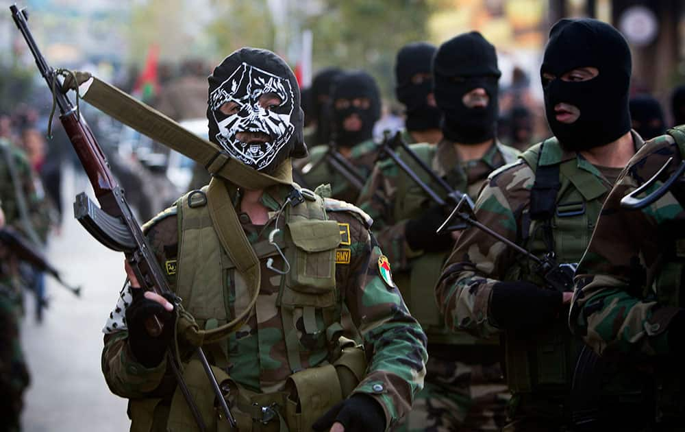 Palestinian security forces march, as they mark the 50th anniversary of the Fatah movement in the West Bank city of Ramallah.