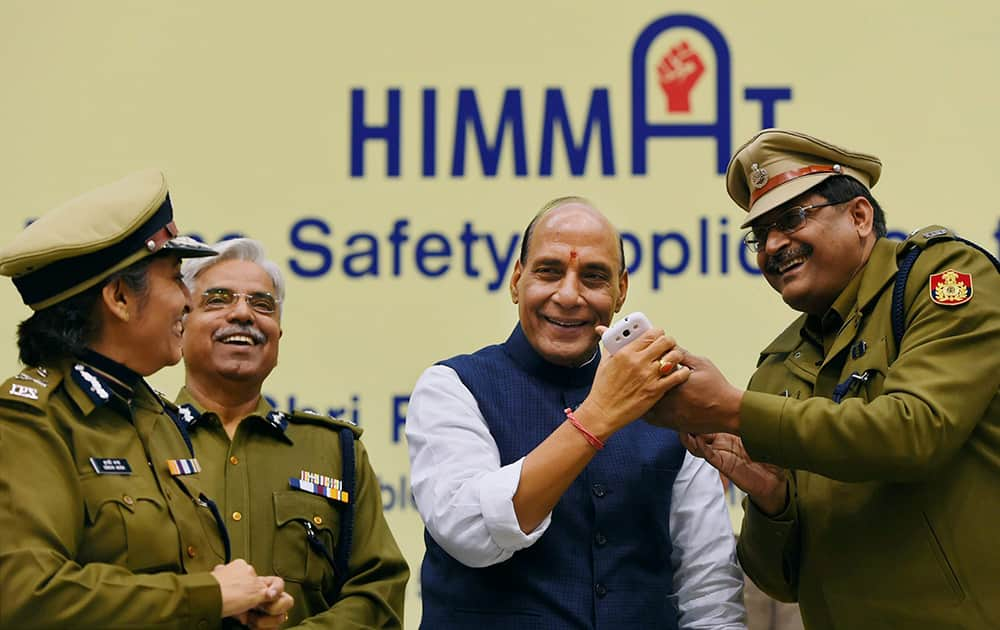 Home Minister Rajnath Singh with Delhi police Commissioner B S Bassi during the launch of mobile phone based application Himmat for the safety of women in the the capital, in New Delhi.