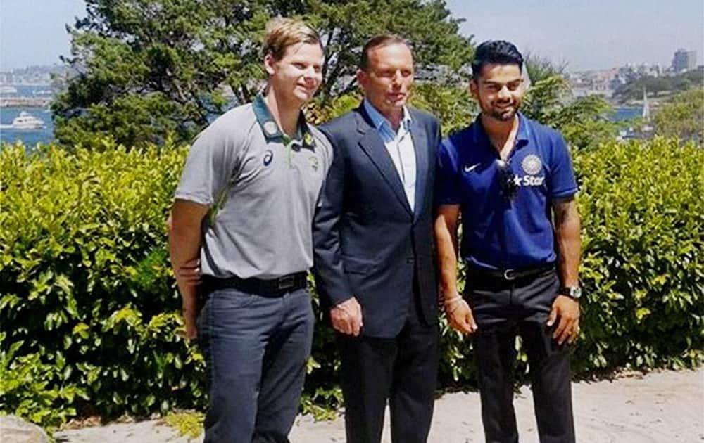 Australian Prime Minister, Tony Abbott with Indian cricket Test team captain Virat Kohli and Australian captain Steven Smith during the afternoon tea hosted by PM Tony Abbott.