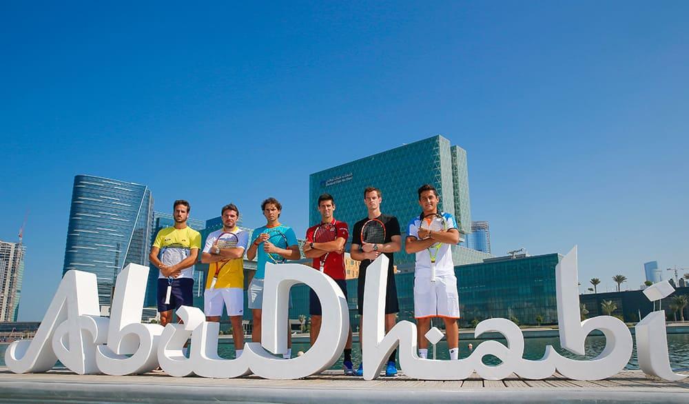 This image released by the Mubadala World Tennis Championship, Feliciano Lopez, Stan Wawrinka, Rafael Nadal, Novak Djokovic, Andy Murray and Nicolas Almagro pose at the UAE capital's Central Business District, Al Maryah Island in Abu Dhabi, United Arab Emirates.