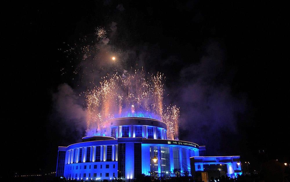 Fireworks go off at the Mahanagar Palika Building on New Years eve, in Navi Mumbai.