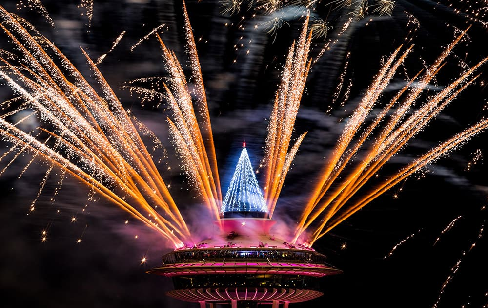 Colorful bursts of fireworks explode along the 605-foot height of the Space Needle during the 'T-Mobile New Year's Eve at the Needle' event, in Seattle, Washington.