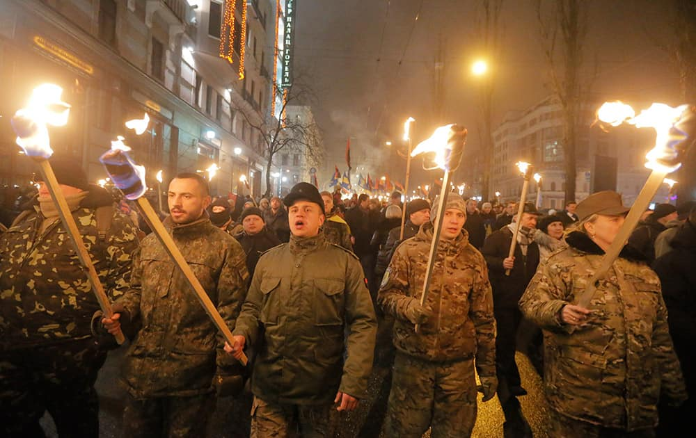 Ukrainian nationalists carry torches during a rally in downtown Kiev, Ukraine.