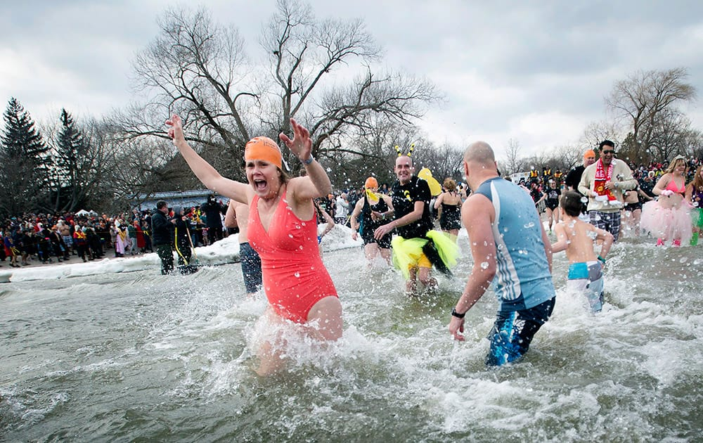 Participants in the Polar Bear Dip run into Lake Ontario in sub-zero temperatures to mark the New Year in Oakville, Ontario, Canada.