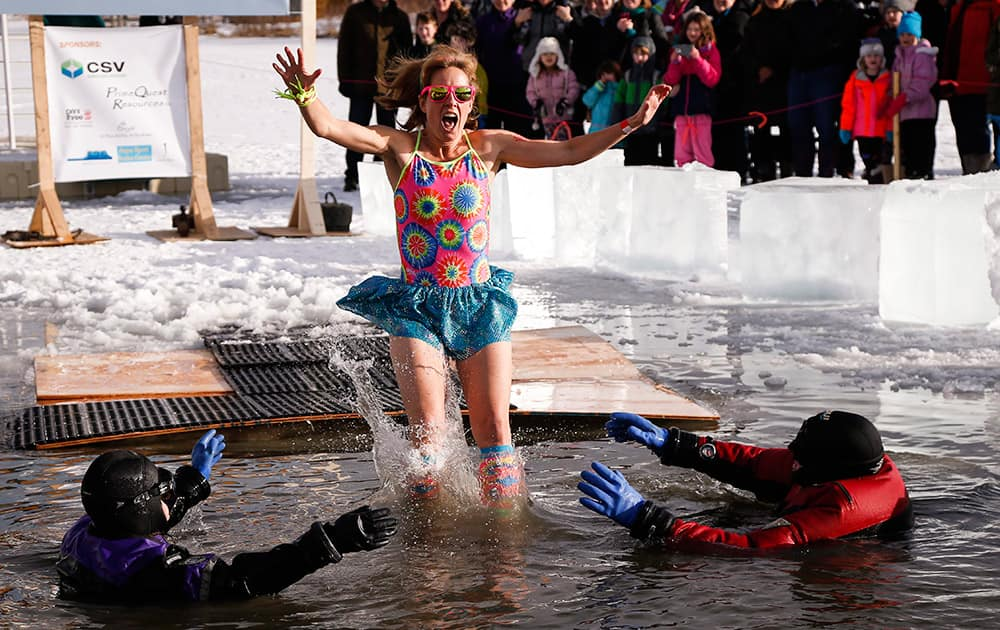 A participant plunges into the water during the annual Polar Bear Dip in Calgary, Alberta.