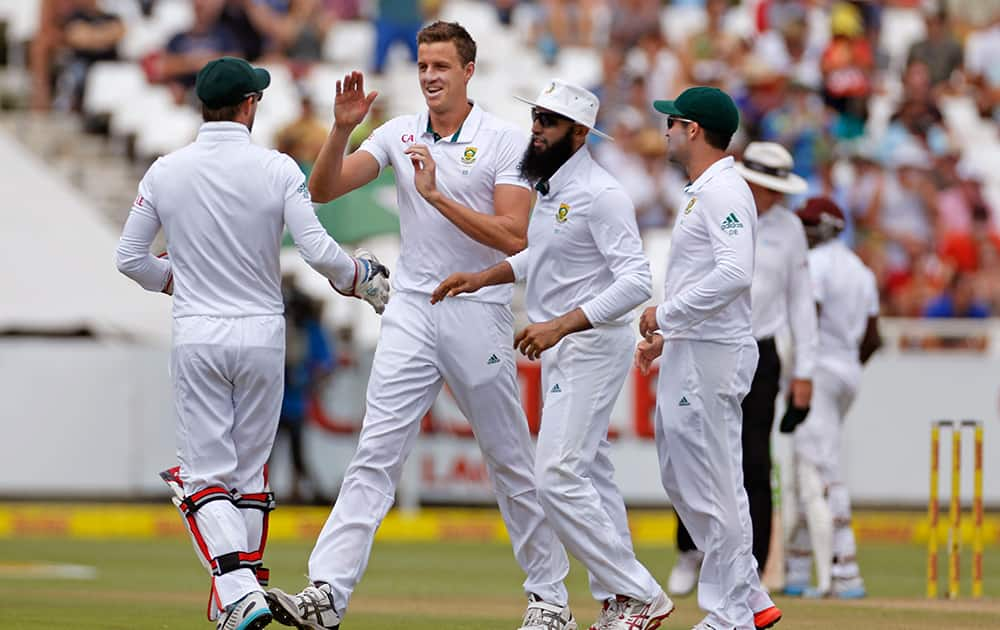 South Africa's Morne Morkel, celebrates with teammates after taking the wicket of West Indies' Jerome Taylor during their third test cricket match in Cape Town.