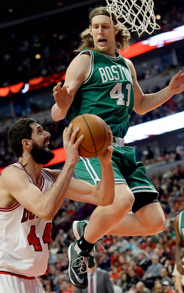 Chicago Bulls forward Nikola Mirotic (44) looks to the basket as Boston Celtics forward Kelly Olynyk (41) guards during the second half of an NBA basketball game in Chicago.