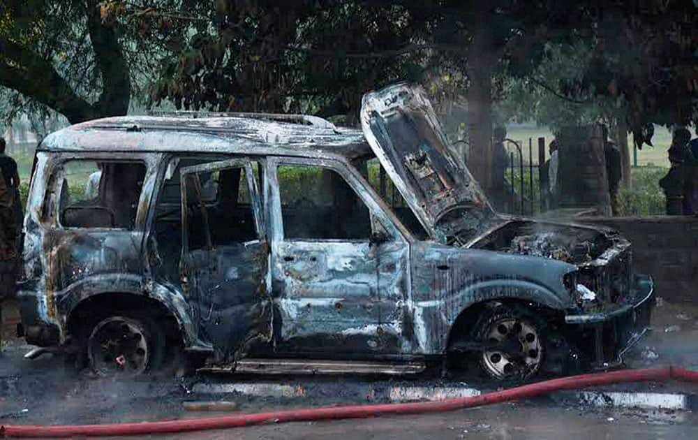 A charred vehicle after a clash between BJP and AAP workers in New Delhi.