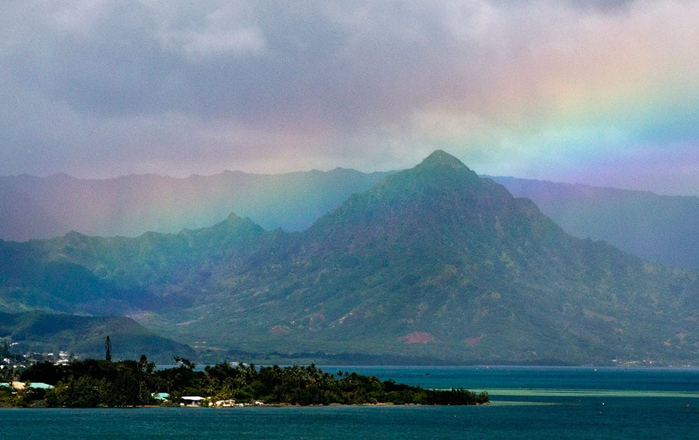President Barack Obama's motorcade passes Kaneohe Bay as heads for the beach at Bellows Air Force Station, on the island of Oahu in Hawaii, on the final day of the Obama family vacation.