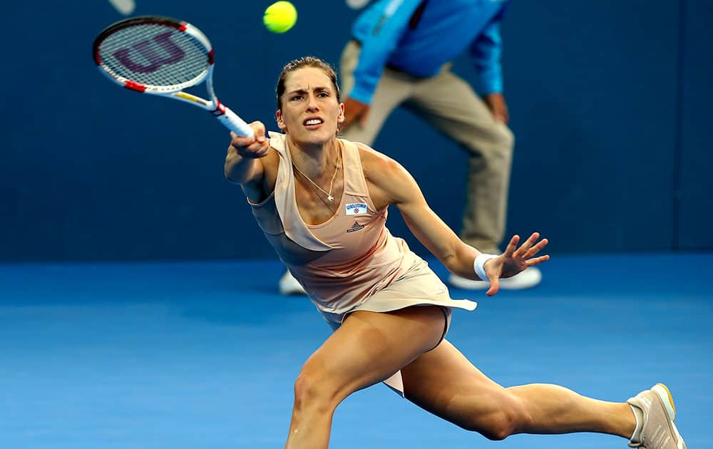 Andrea Petkovic of Germany plays a shot during her first round match against Estonia's Kaia Kanepi at the Brisbane International tennis tournament in Brisbane, Australia.