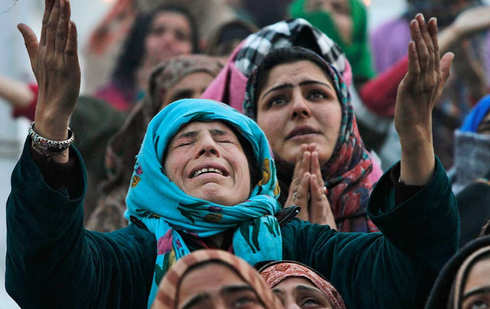 A Kashmiri woman cries as she prays at the Hazratbal shrine on Eid-e-Milad, or birth anniversary of Islam's Prophet Muhammed in Srinagar.