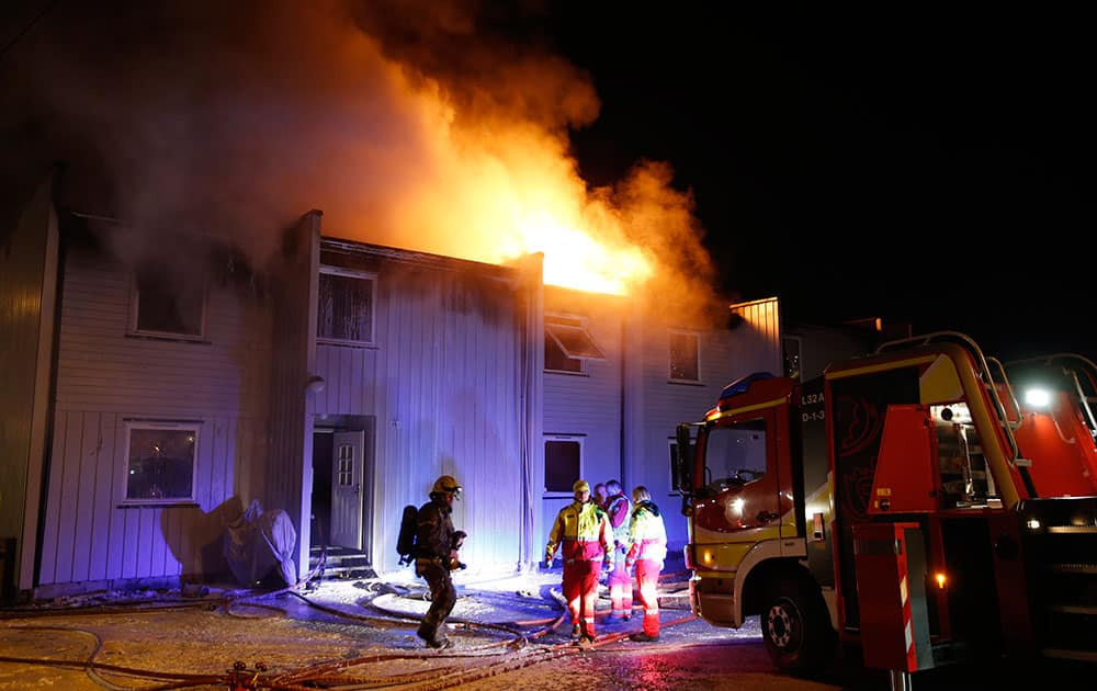 Three people were found dead inside a flat in a burning building in Solbergelva, some 40 km south of Oslo.