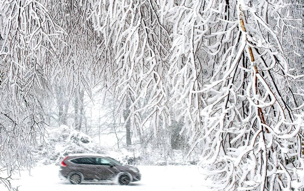 A car moves throught a winter landscape near Sedlonov, East Bohemia.