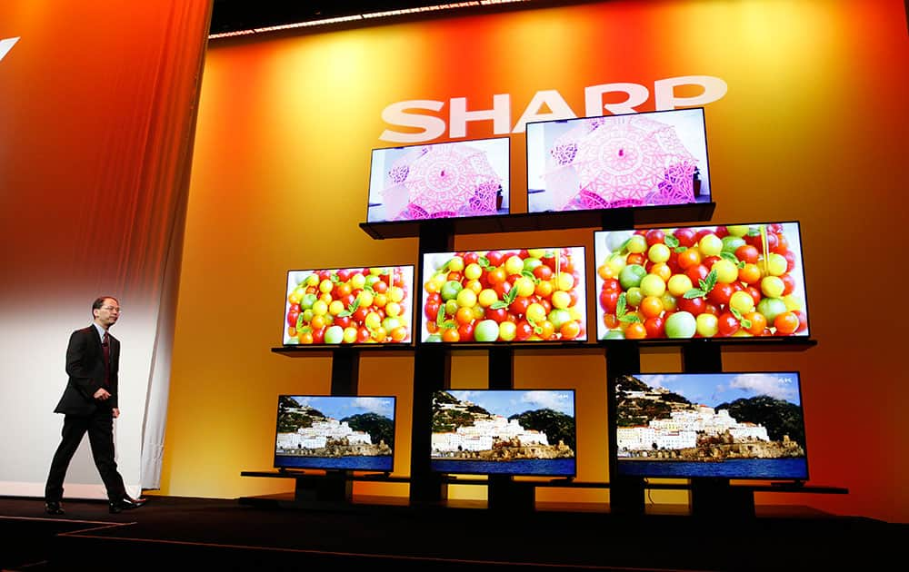 Toshiyuki Osawa, president of Sharp Electronics Corporation, introduces Sharp 4K Ultra HD televisions, at the International CES in Las Vegas.