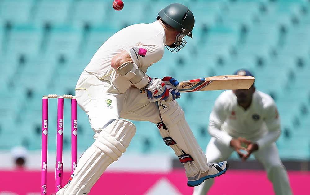 Australia's Chris Rogers is hit by a delivery from India's Mohammad Shami during their cricket test match at the Sydney Cricket Ground in Sydney.