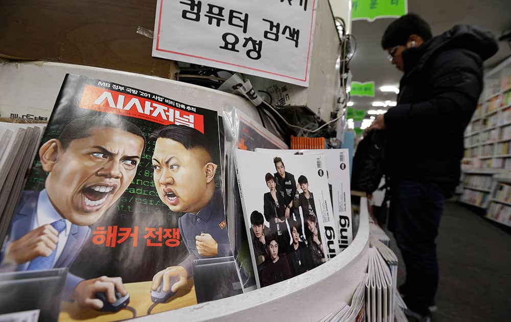 a magazine with caricatures of US President Barack Obama and North Korean leader Kim Jong Un is displayed at a book store in Seoul, South Korea.