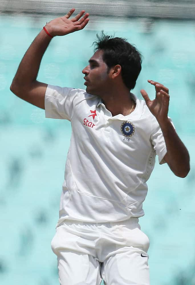 India's India's Bhuvneshwar Kumar reacts to Australia making runs off his bowling during their cricket test match in Sydney