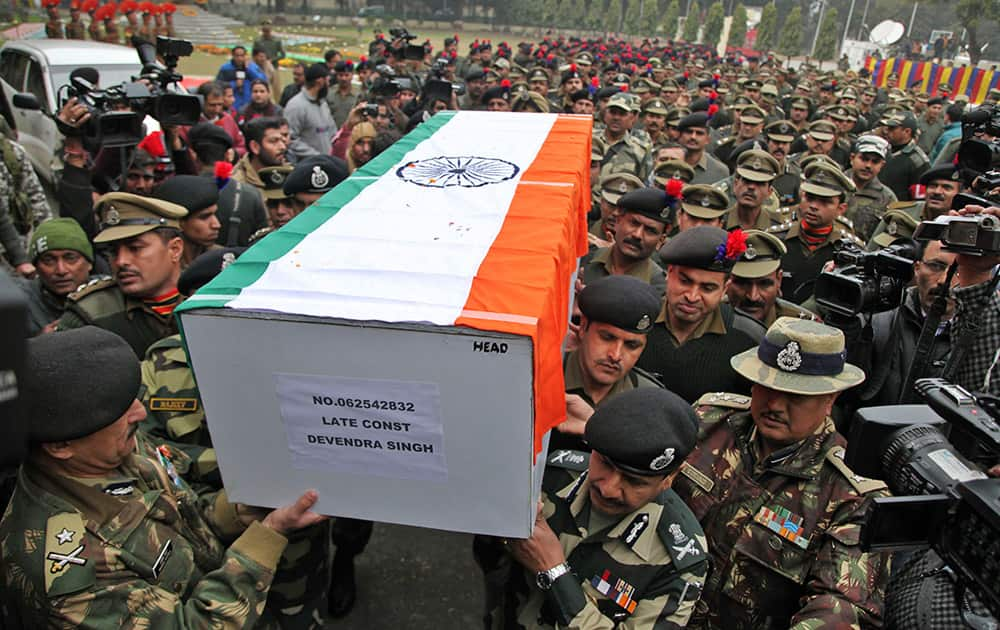 Indian Border Security Force (BSF) officers carry the coffin of their colleague who was killed in a India Pakistan cross border firing, in Jammu.