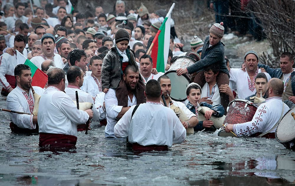 Believers sing and dance in the icy water of the river Tundzha as they celebrate Epiphany day, a Christian festival, in the town of Kalofer, Bulgaria.