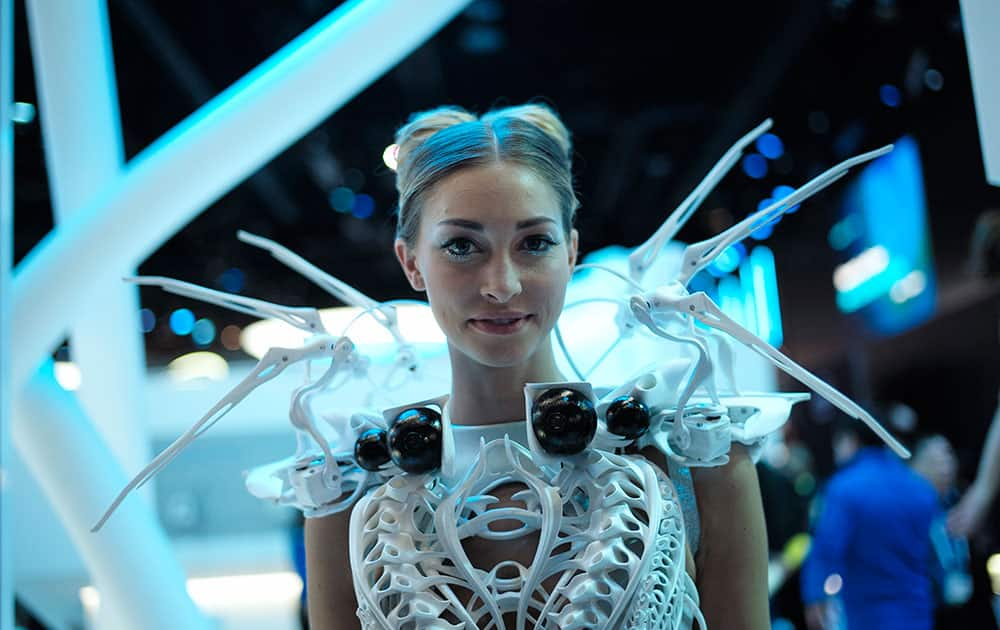 A model wearing robotic dress with proximity sensors pauses for photos at the Intel booth at the International CES, in Las Vegas.
