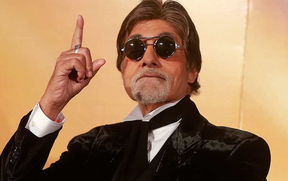Bollywood superstar Amitabh Bachchan gestures during the trailer launch of his upcoming film