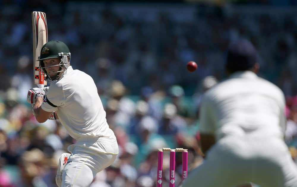 Australia's Shaun Marsh, turns to see the ball he has nicked heading toward the Indian wicketkeeper Wriddhiman Saha to be caught out for 73 runs on the second day of their cricket test match in Sydney.