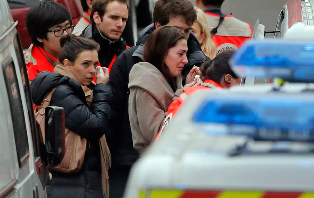 People are evacuated outside the French satirical newspaper Charlie Hebdo's office, in Paris.