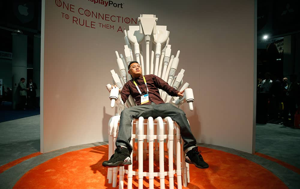 Roman Baure sits in a chair at the DisplayPort booth during the International CES in Las Vegas.