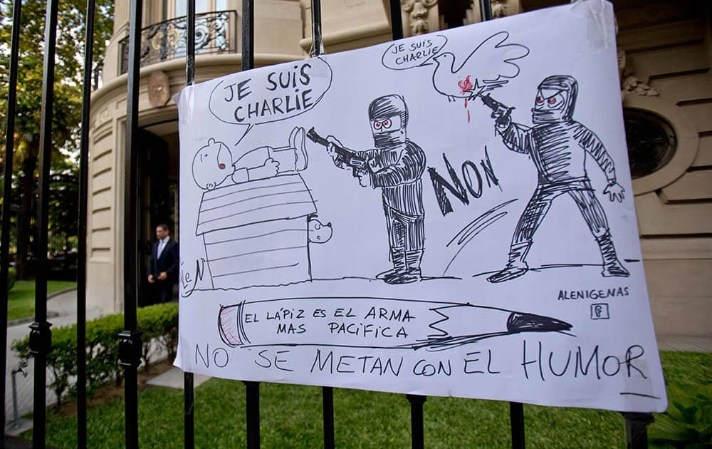 A cartoon style drawing hangs outside France's embassy that reads in Spanish