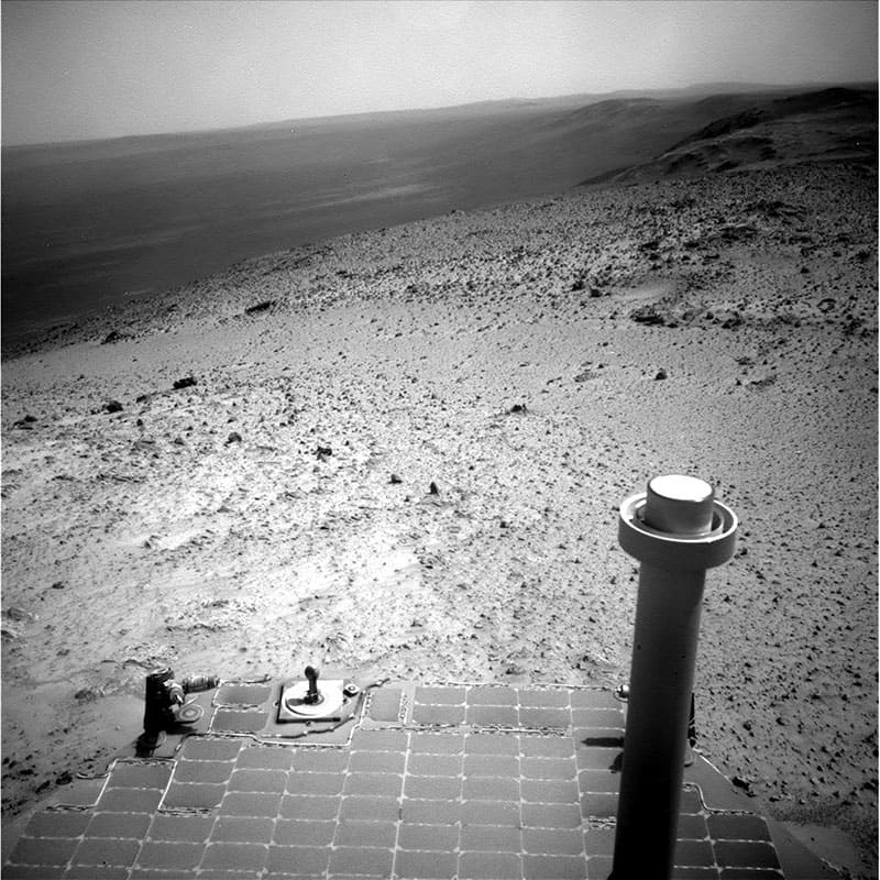 This image sent by NASA`s Opportunity rover, shows a view from atop a Martian hill. Opportunity will spend several days at the summit making pictures that engineers will stitch into a color panorama.