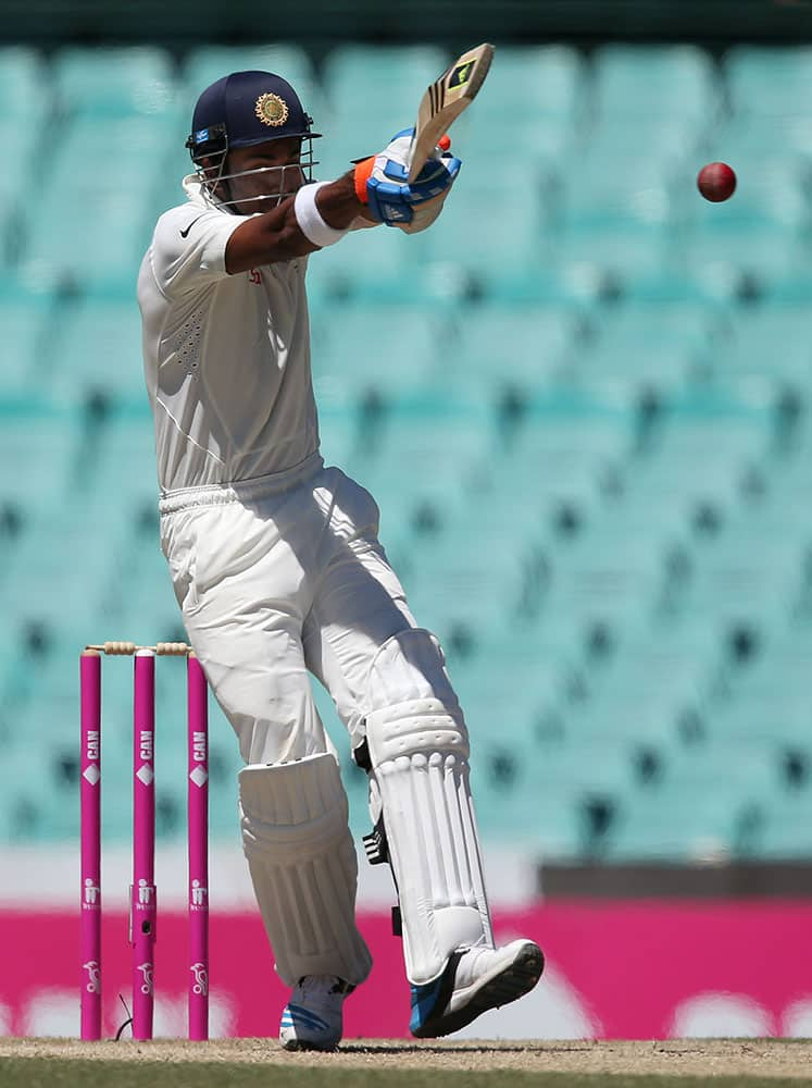 India's Lokesh Rahul hooks the ball from Australia's Josh Hazelwood on the third day of their cricket test match in Sydney.