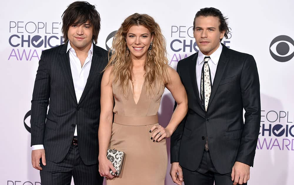 Reid Perry, from left, Kimberly Perry and Neil Perry of The Band Perry arrive at the People's Choice Awards at the Nokia Theatre.