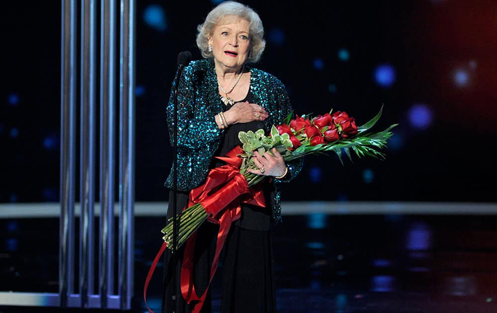Betty White accepts the award for favorite TV icon at the People's Choice Awards at the Nokia Theatre.
