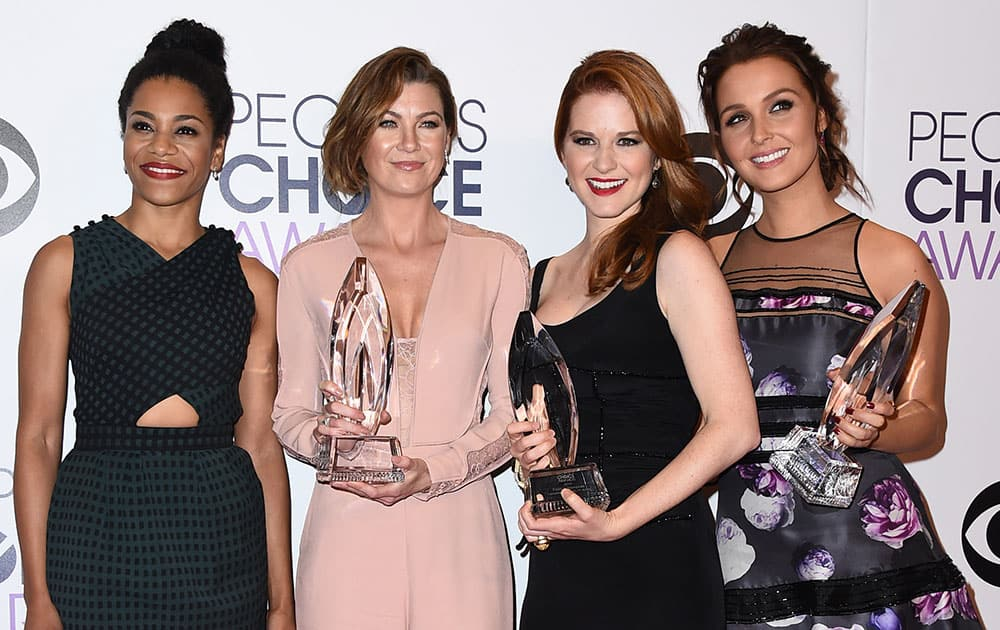 """Kelly McCreary, from left, Ellen Pompeo, Sarah Drew, and Camilla Luddington of """"Grey's Anatomy"""" pose in the press room with the award for favorite network TV drama at the People's Choice Awards at the Nokia Theatre in Los Angeles."""