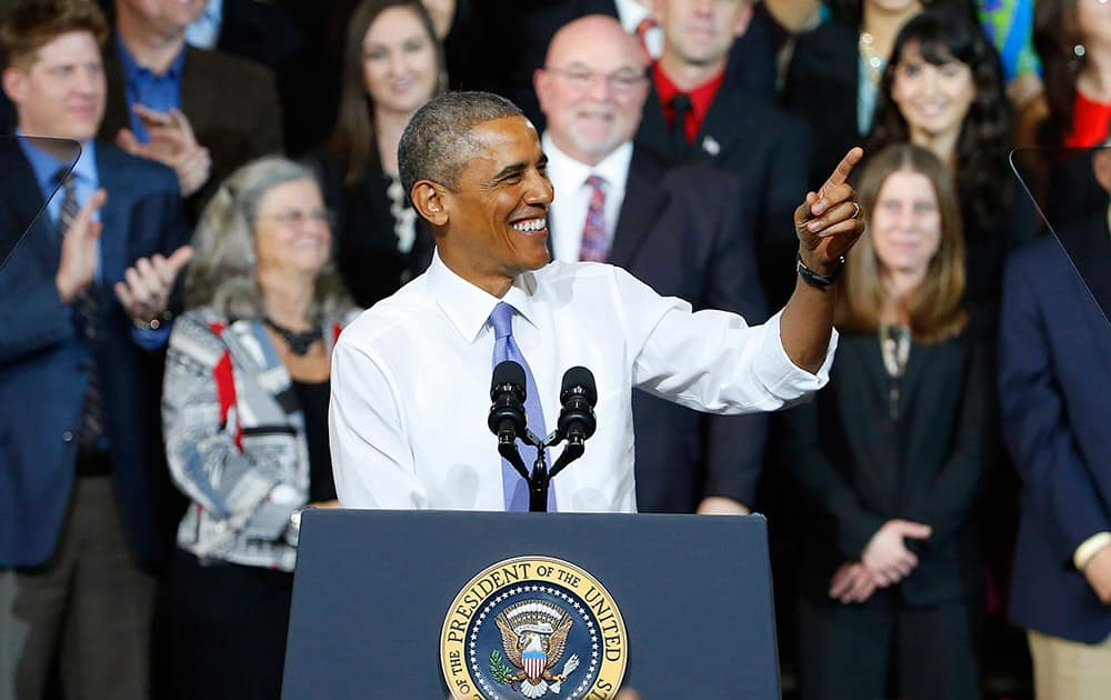 President Barack Obama smiles as he gives a speech about housing and home ownership as he announces a cut in mortgage insurance premiums on Federal Housing Administration loans, a move aimed at attracting new homebuyers, at Central High School in Phoenix.