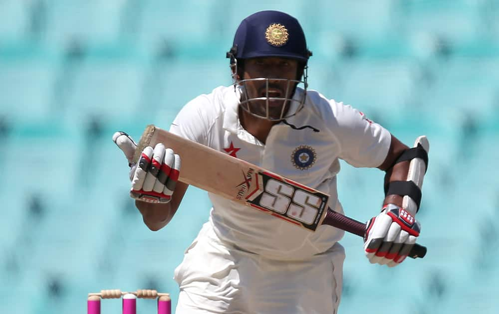 Wriddhiman Saha makes runs against Australia on the fourth day of their cricket test match in Sydney.