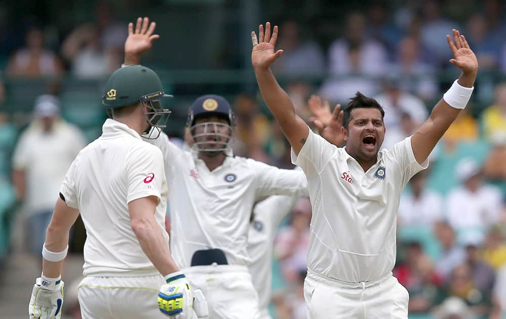 Suresh Raina, appeals to the umpire for a LBW decision on Australia's Chris Rogers on the fourth day of their cricket test match in Sydney.