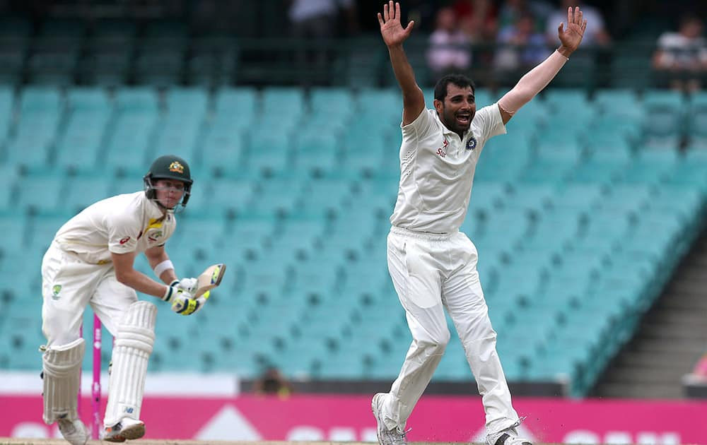 India's Mohammad Shami, appeals for a LBW decision and is granted it on Australia's Steve Smith, out for 71 runs on the fourth day of their cricket test match in Sydney.