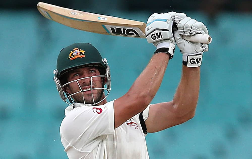 Australia's Joe Burns drives the ball against India on the fourth day of their cricket test match in Sydney.