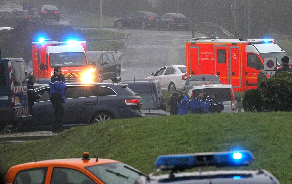 Ambulances arrive in Dammartin-en-Goele, northeast Paris, as part of an operation to seize two heavily armed suspects.