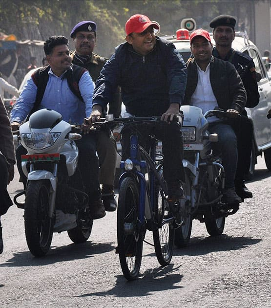 UP Chief Minister Akhilesh Yadav pedals a cycle during the ongoing Saifai Mahotsav in Etawah.