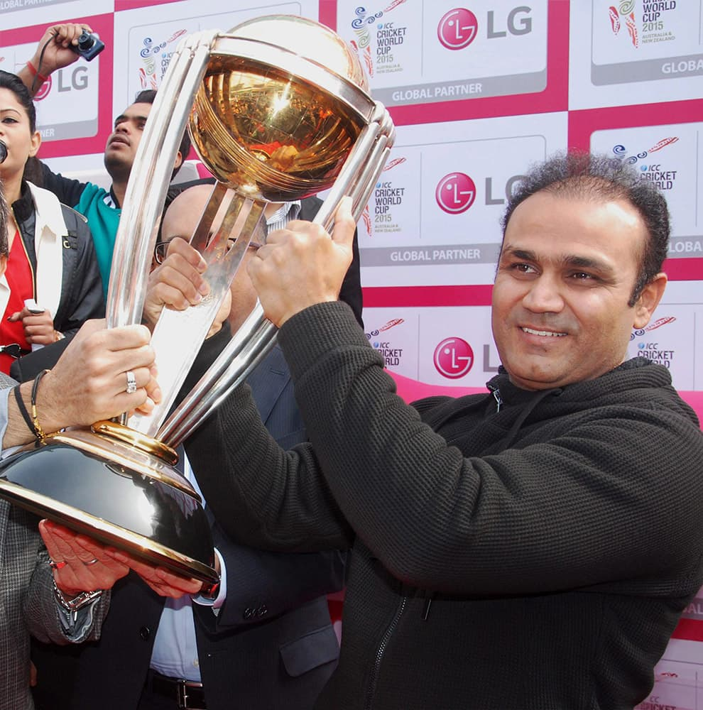 Virender Sehwag displays the ICC World Cup 2015 trophy at an event in Gurgaon.