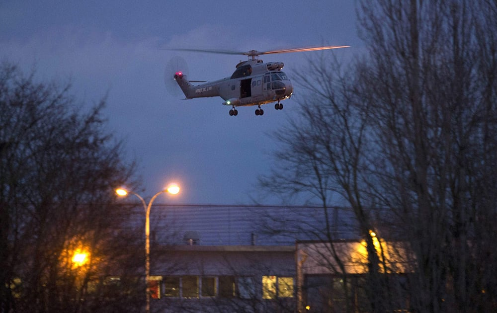 A helicopter flies over a building, where the suspects of a shooting at a Paris newspaper office were holed up, after security forces stormed it in Dammartin-en-Goele, France.