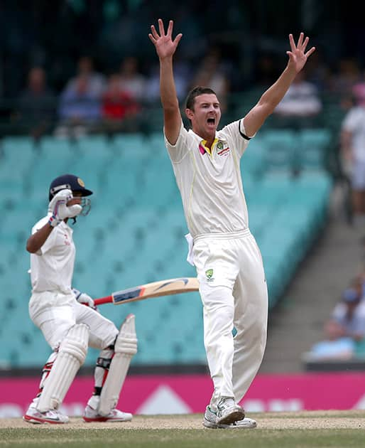 Australia's Josh Hazelwood, appeals to the umpire for a LBW decision on India's Ajinkya Rahane, on the fifth day of their cricket test match in Sydney.