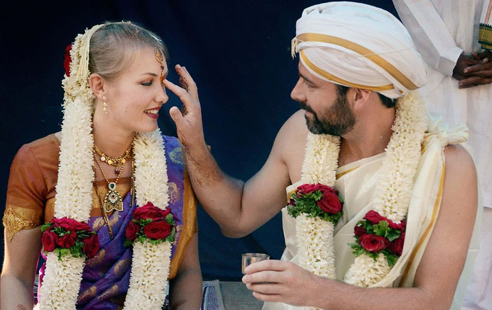 London Based Garry and Sweden Based Cecelia getting married as per the Indian customs at Sullia, 90 kms from Mangaluru.
